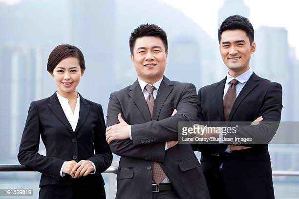 cheerful business team arms crossed, hong kong - ミッドアダルト ストックフォトと画像