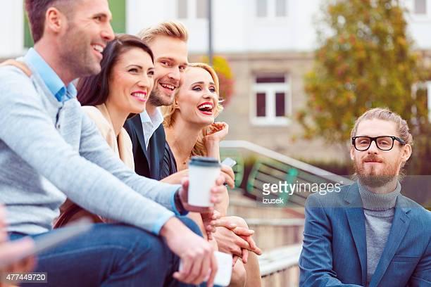 cheerful business team having coffee break outdoor - izusek stock photos and pictures
