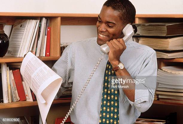 Cheerful businessman on the telephone