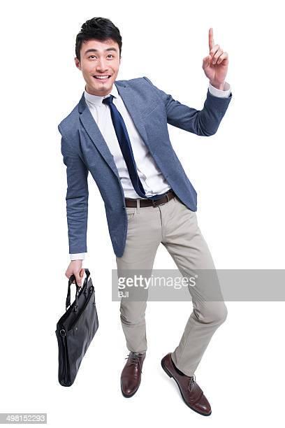 Cheerful businessman raising finger