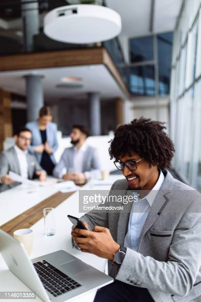 cheerful businessman using mobile phone and text messaging - incidental people stock pictures, royalty-free photos & images