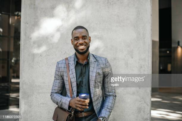 cheerful businessman with cup of hot beverage - reusable stock pictures, royalty-free photos & images