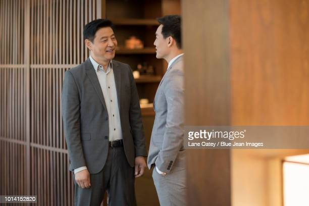 cheerful businessmen talking - open collar stock pictures, royalty-free photos & images