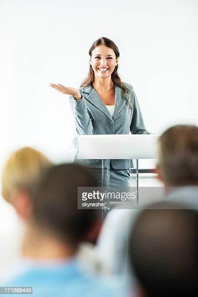 Cheerful businesswoman having a public speech.