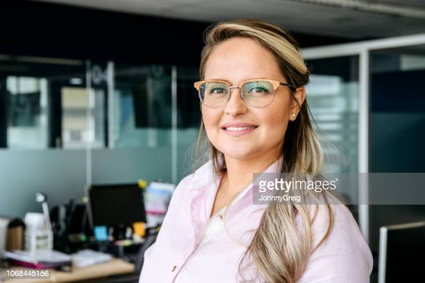 cheerful businesswoman in her 30s smiling - 30 34 years stock pictures, royalty-free photos & images