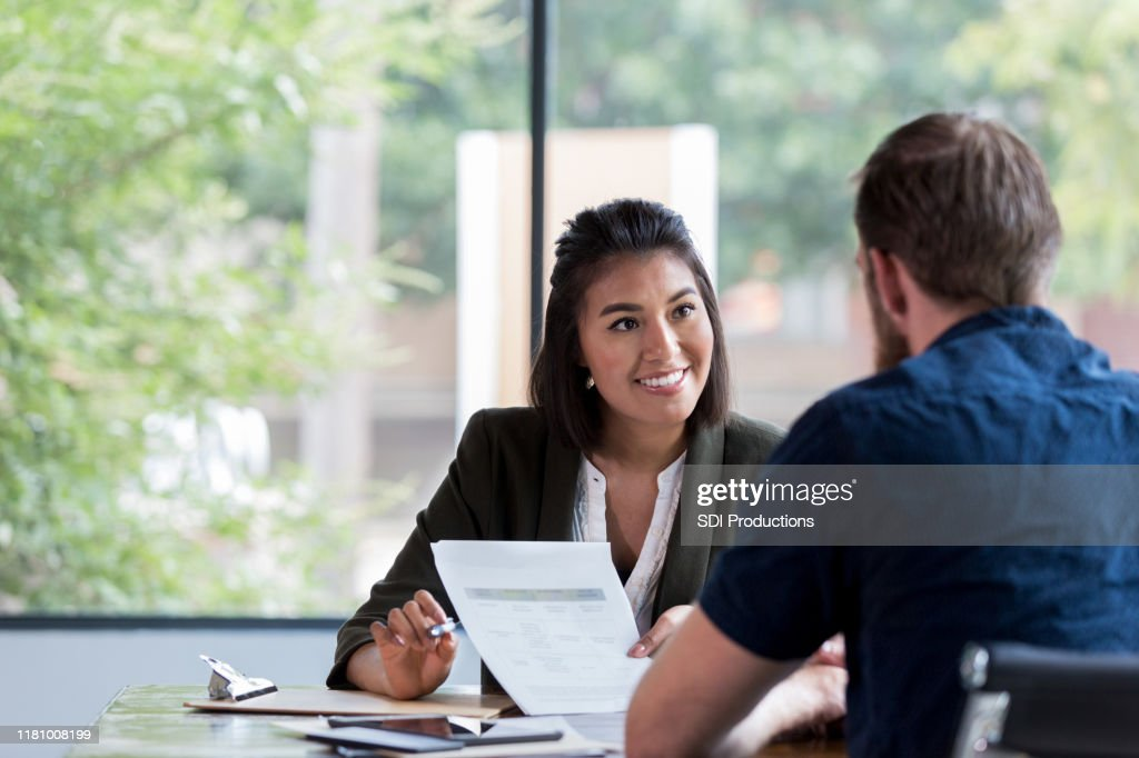 Cheerful businesswoman meets with client : Stock Photo