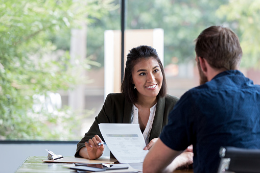 Cheerful businesswoman meets with client 1181008199