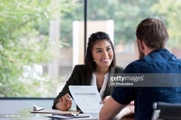 cheerful businesswoman meets with client - professione foto e immagini stock