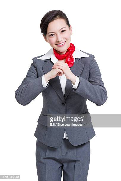 Cheerful businesswoman offering traditional Chinese New Year greeting