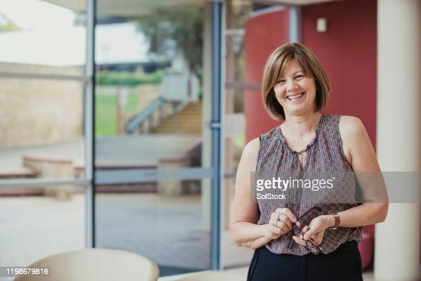 cheerful businesswoman - teacher stock pictures, royalty-free photos & images