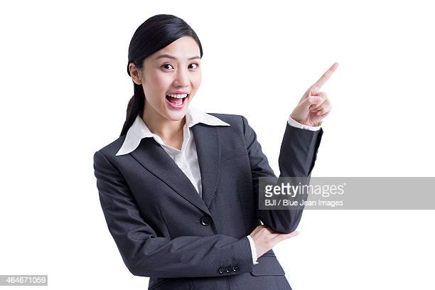 Cheerful businesswoman pointing