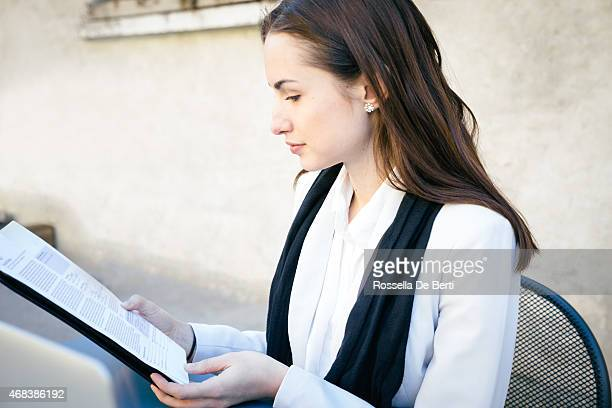 cheerful businesswoman reading documents - article stock pictures, royalty-free photos & images