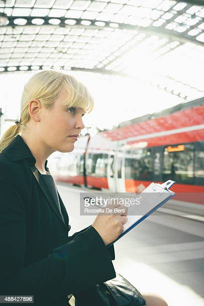 Cheerful Businesswoman Taking Notes