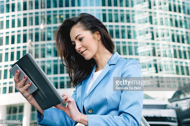 cheerful businesswoman using digital tablet during coffee break - moscow international business center stock photos and pictures