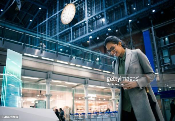 cheerful businesswoman using her smartphone