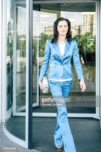 Cheerful Businesswoman Walking Through Revolving Doors