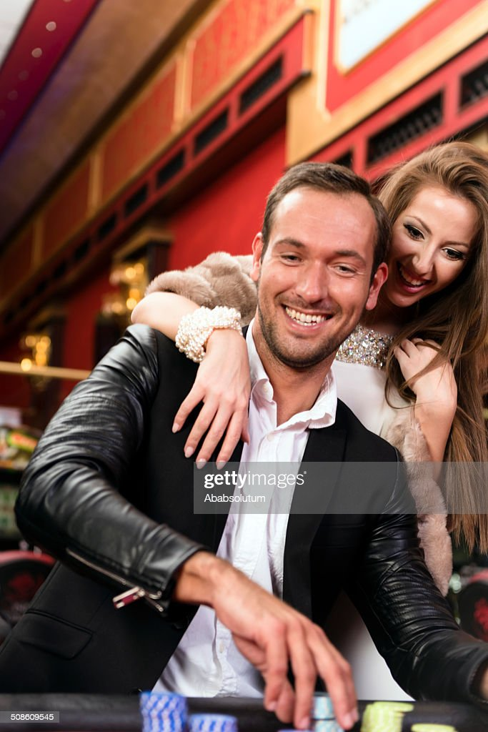 Cheerful Casino Players, Roulette Game : Stock Photo