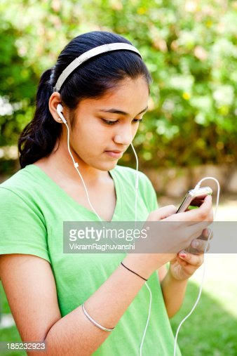 Cheerful Casual Indian Teenage Girl Listening Music Stock -1094