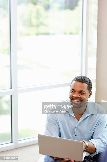 cheerful casually dressed professional using laptop - open collar stock pictures, royalty-free photos & images