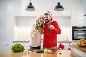 cheerful caucasian adorable couple standing kitchen