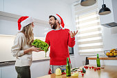cheerful caucasian couple preparing healthy dinner