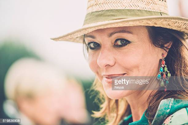 Cheerful caucasian mature woman with straw hat