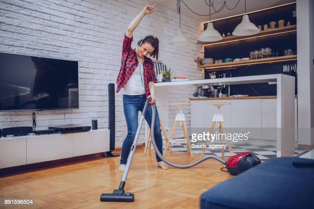 cheerful cleaning - stereotypical homemaker stock pictures, royalty-free photos & images