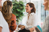 Cheerful colleagues laughing during corporate event
