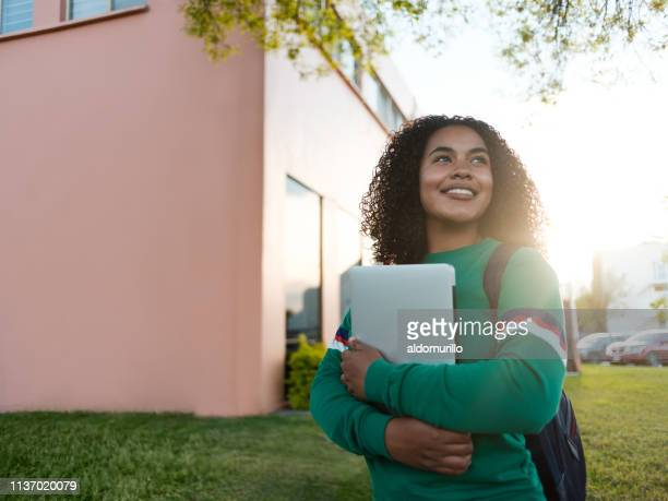 cheerful college girl gazing to the side - high school student stock pictures, royalty-free photos & images