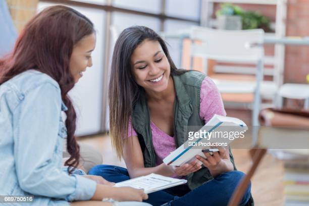 Cheerful college girls study together