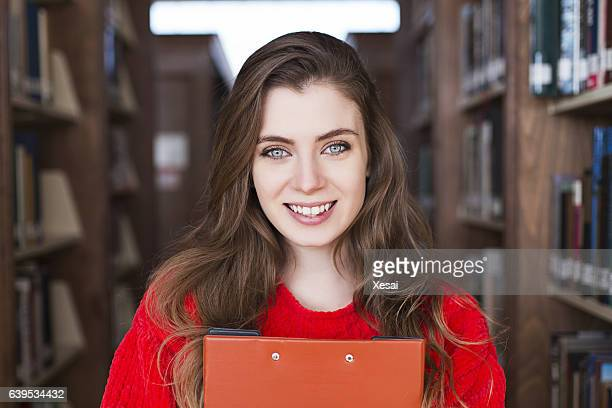 cheerful college student at library