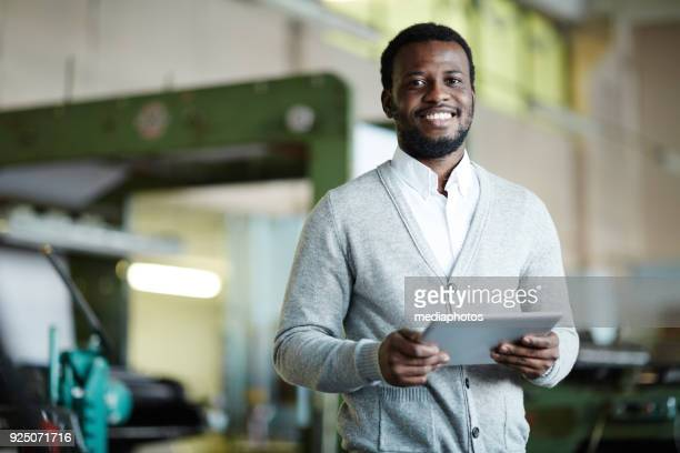 cheerful confident african printing worker with tablet - owner stock pictures, royalty-free photos & images