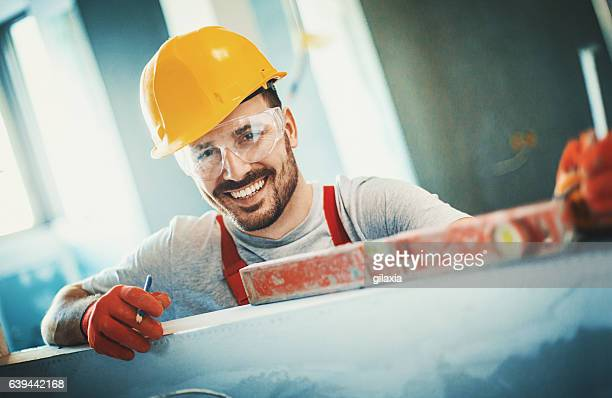 cheerful construction worker. - wall building feature stock pictures, royalty-free photos & images