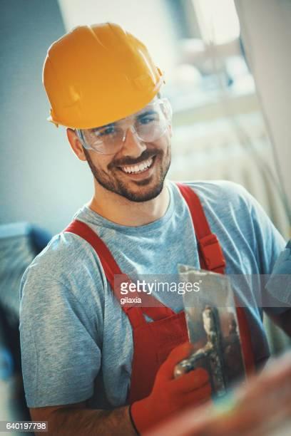 Fröhlich Bauarbeiter.