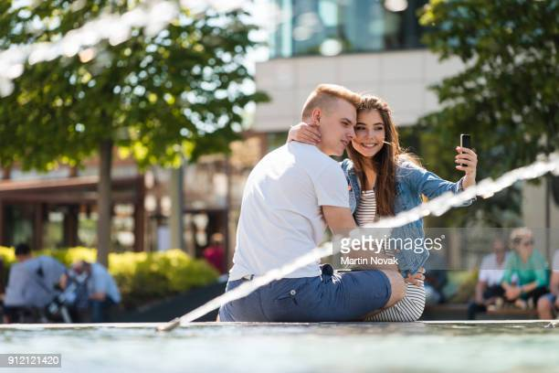 Cheerful couple capturing a romantic moment