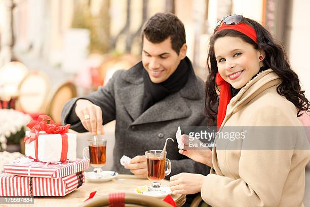 Cheerful couple drinking tea