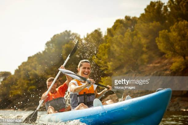 cheerful couple enjoying kayaking - kayak stock pictures, royalty-free photos & images