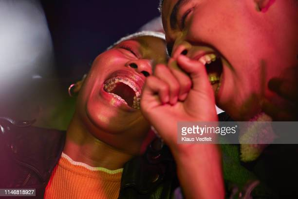 cheerful couple enjoying movie - lachen stockfoto's en -beelden