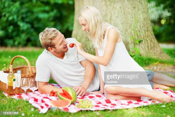 Cheerful couple enjoying their vacation in a park