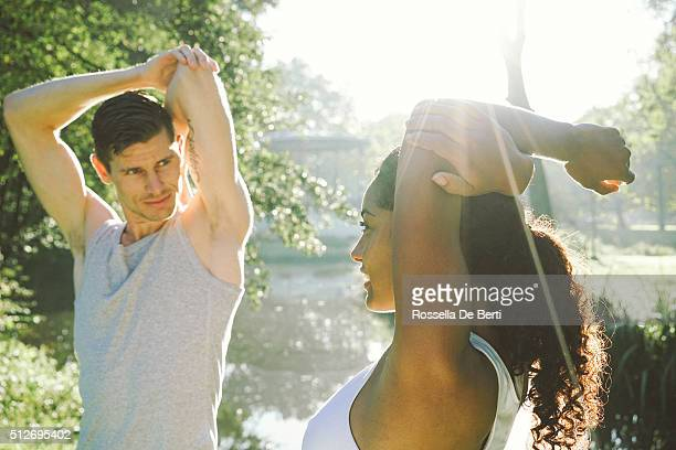 Cheerful Couple Exercising Outdoors In The Early Morning