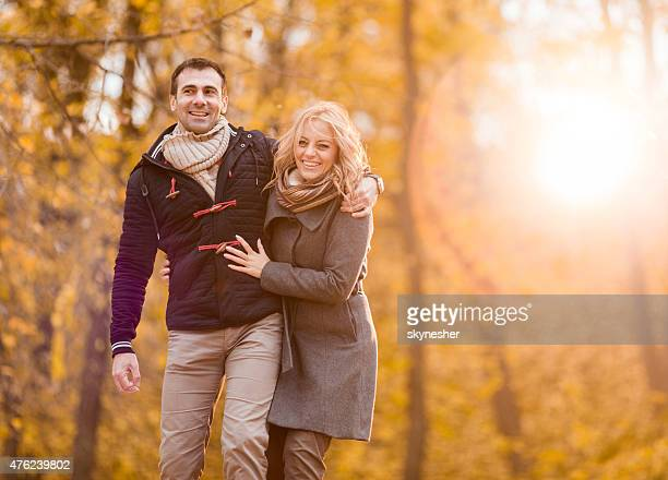 Cheerful couple in enjoying nature and looking at camera.