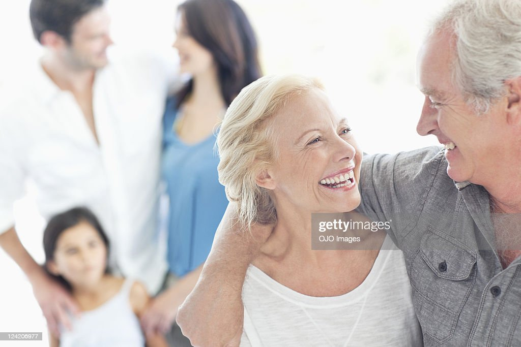 Cheerful couple looking at each other : Stock Photo
