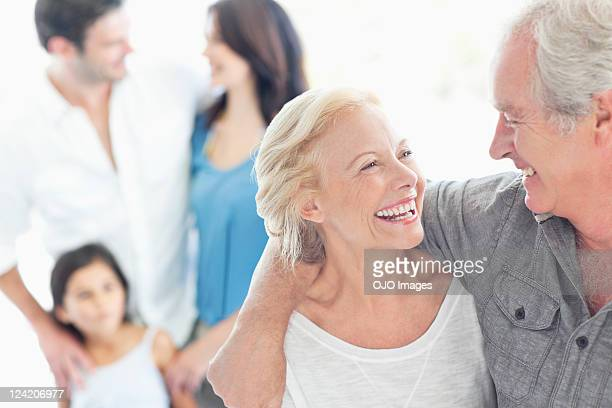 Cheerful couple looking at each other