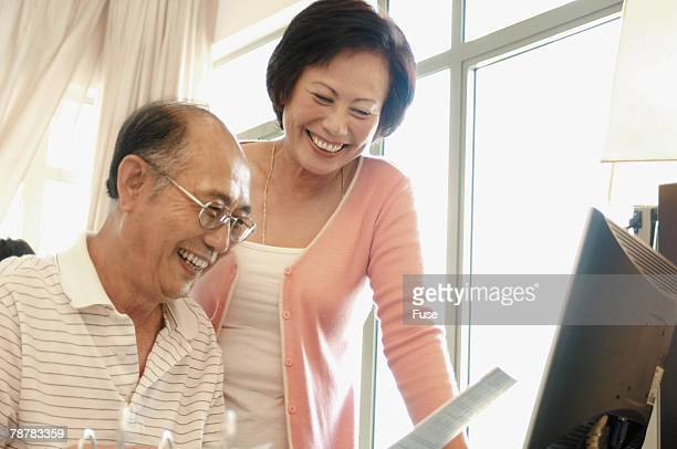 Cheerful Couple Reading Letter