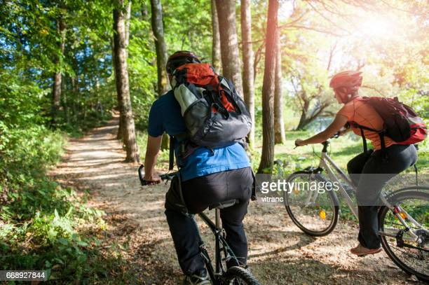 Cheerful Couple Riding Bicycle Together