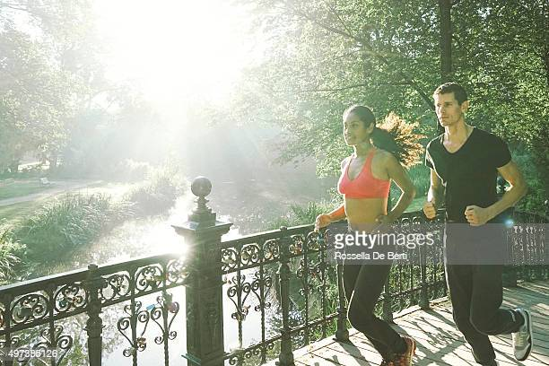 Cheerful Couple Running Outdoors In The Early Morning