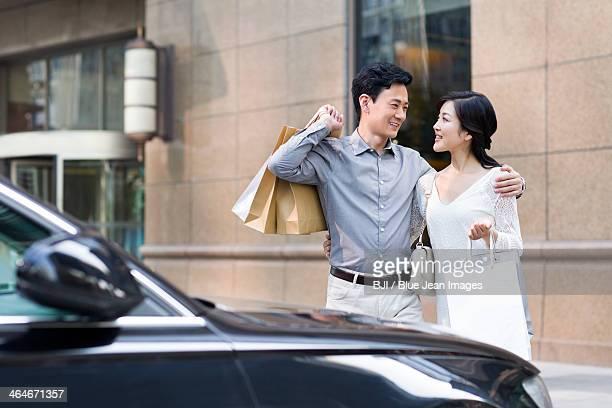 cheerful couple shopping - 日曜日 ストックフォトと画像