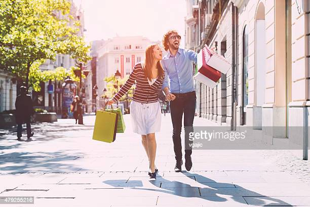 Cheerful couple shopping together.