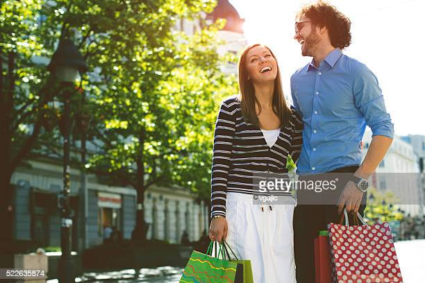 Cheerful couple shopping together
