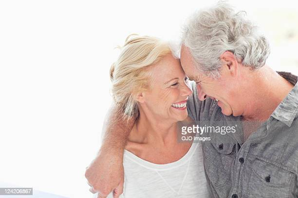 Cheerful couple staring at each other and smiling
